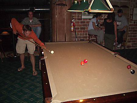 Josh Carlson and Gabe Lueders playing pool at Raccoon River Brewing