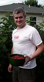 Dave Picking Raspberries in His Backyard